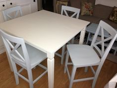 Doily White Dining Table with Four Light Blue Chairs