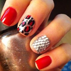 Not sure about the rhinestone nail, but I love the leopard accent!