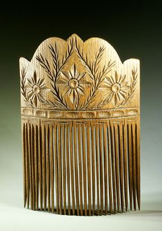 carved wood hair comb