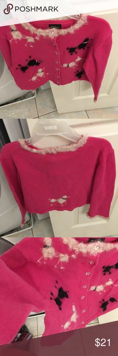 Girl's pink button-up sweater (SZ 4) In FANTASTIC CONDITION!!!!!!  Worn once. Clear buttons running the length of the sweater, along with Pom-pom dog details are nice, personal touches.  😊 Willing to negotiate, so don't hesitate to make an offer!!!!!! Susan Bristol Shirts & Tops Sweaters