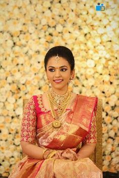South Indian bride. Gold Indian bridal jewelry.Temple jewelry. Jhumkis. Red silk kanchipuram sari.braid with fresh jasmine flowers. Tamil bride. Telugu bride. Kannada bride. Hindu bride. Malayalee bride.Kerala bride.South Indian wedding.