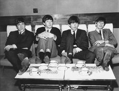 Beatles holed-up in a hotel, looking bored.