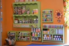 craft paint storage - love her wall shelves - so cute and mostly (or all?) thrifted, and painted to match. Everything in its place, and visible and within easy reach. And so colorful! What more can you ask for? I want to remember this, in case I ever get a large enough space. :) #Crafts #Storage - pb†å