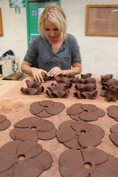 A ceramic artist at Johnson Tiles in Stoke-on-Trent making the ceramic poppies for the Tower of London.