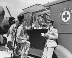 Red Cross volunteers feed pilots ands crew from a mobile canteen at an Army airport outside Washington, D.C.
