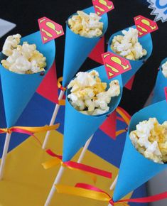 popcorn kaped kones. Cute idea for any theme by just changing the cone.