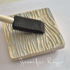 woodgrain stamp using a block of wood and hot glue gun to draw woodgrain pattern