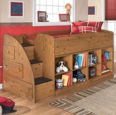 Add the loft bed with tons of storage to your youth bedroom. Storage steps on the end make it easy and fun to reach the top bunk. The drawers at the side of the steps are sure to come in handy for clothes, blankets, and other necessities.  At the base of the loft two open bookcase units add even more areas to keep toys and essentials.