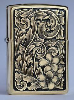 Hand engraved Zippo with Plumaria blossom: