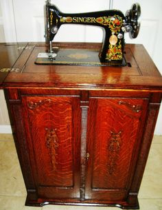 Singer Model 66 Red Eye Antique Sewing Machine Pristine Carved Oak Parlor Cabinet: Absolutely beautiful! $$$