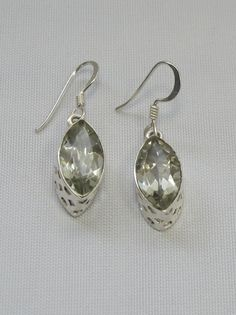 "Brilliant hand-matched set of faceted marquis Green Amethyst gemstones, set in 925-hallmarked sterling silver. Earring length: .75"" Width: .3"""