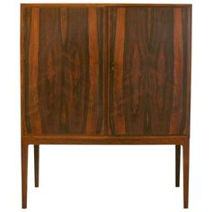 Vintage Danish Rosewood Cabinet | From a unique collection of antique and modern cabinets at https://www.1stdibs.com/furniture/storage-case-pieces/cabinets/