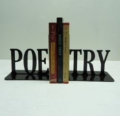 """$22 """"POE-TRY"""" bookends. (I've decided I want to organize [some of] my books according to these adorable bookends)."""