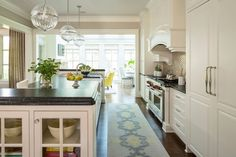 Transitional Kitchen with Hardwood floors, Glass panel, Raised panel, Built-in…