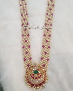 Stunning long haaram with multi layer pearl chains. Long haaram with chaandbali design pendant. Bead Jewellery, Gems Jewelry, Pearl Jewelry, Beaded Jewelry, Jewelery, Beaded Necklace Patterns, Pearl Chain, Gold Beads, Diamond Pendant