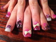 feathers, glitter nails, 3d charms    call Kristal at 916-670-0010 for an appointment in Sacramento