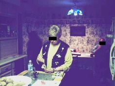 Michelle Spitler took this photo in her kitchen of her current in-laws while they were visiting one night and this shadow apparition appeared  - Michelle and her new husband have had previous experiences with it in their home and believe it is her deceased husband