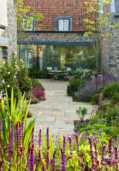 """Beautiful winning gardens from the SGD awards: in pics - The International Award winner was Debbie Roberts for her garden in Le Haut, Guernsey. The judges said: """"An amazing garden with intense displays of co. Small Courtyard Gardens, Small Courtyards, Back Gardens, Small Gardens, Modern Gardens, Courtyard Design, Patio Design, Exterior Design, Modern Garden Design"""