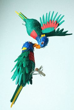 Sculpture. Serie of 2 rainbow parrots. Im not sure if this situation is true in real nature, but i like when love happens in risk situations...   Paper cut. 2012.