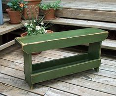 Oooh, instead of us having our rainboots standing by the front door, they could go in a pretty boot bench like this