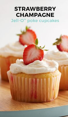 These boozy strawberry jello poke cupcakes are the perfect easy treat for a bridal shower or potluck! What's better than a cupcake with a little champagne? We can't think of anything.