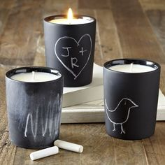 DIY Inspiration - Chalkboard Candle Holders. These are sold through West Elm but the idea would be easy to recreate with chalkboard spray paint or even chalkboard vinyl.