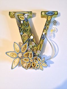 """Quilled letter """"V"""" Veronica , 6 x 6 , free standing , olive green, pale yellow, and pale blue.https://www.etsy.com/shop/QuillingKimStarcher"""