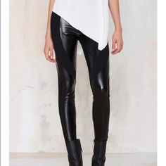 #150 nasty gal These vegan leather leggings are what wardrobe dreams are made of. They're black with vegan leather inserts, stretch fabric, and architectural-inspired detailing. They're perfect with anything from an oversized sweater to a tissue-thin tee. By Nasty Gal. *Polyester/Viscose/Spandex/Polyurethane *Runs true to size *Model is wearing size small *Hand wash cold *Imported Nasty Gal Pants Leggings
