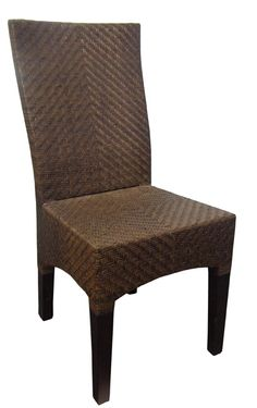 """A classic shape dining chair, with a contemporary feel, that combines the comfort and organic texture of tobacco woven rattan with that """"lush minimalism"""" of the tropics. Try pairing with a dark stained dining table to complement the rattan and leg tonings."""