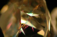 A fracture filled diamond showing flashes of pink and blue