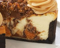 ADAM'S PEANUT BUTTER CUP FUDGE RIPPLE: Cheesecake, Reese's, and Butterfinger all baked on a chocolate crust topped with even more Reese's and Butterfinger, and finished with peanut butter cream cheese rosettes. Available at The Cheesecake Factory.