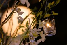 Delicate tea lights and beads hanging off the trees decorating the wedding table. Beautiful Islands, Tree Decorations, Unique Weddings, Wedding Table, Tea Lights, Light Bulb, Florals, Delicate, Trees