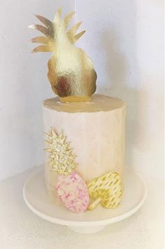www.lovebeecakes.blogspot.com   Pineapple cake with watercolor triangles. Gold leaf and gold painting.