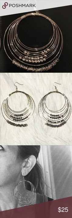 """NWOT Oversized Silver Beaded Wire Circle Earrings New without tags silver earrings have multiple wire circles with floating beads.   Oversized Statement earrings are for pierced ears only.  Length 3.75"""".   Circle diameter approx 3"""". Jewelry Earrings"""
