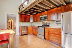 A small, restored home with loft made from reclaimed wood in Columbus, Ohio. More info. here.