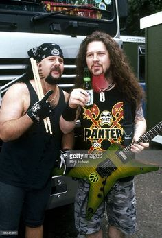 Photo of Dimebag DARRELL and Vinnie PAUL and PANTERA; Vinnie Paul and Dimebag Darrell, posed, with beer