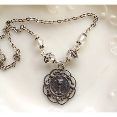 A First Communion necklace designed to be a keepsake and heirloom. Lovely vintage Host and Chalice medal.