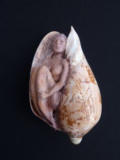 Polymer clay sculpting within beach shell