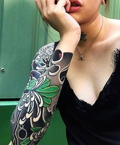 Japanese tattoo sleeve by @horisame.  #japaneseink #japanesetattoo #irezumi #tebori #colortattoo #colorfultattoo #cooltattoo #largetattoo #armtattoo #tattoosleeve #girltattoo #tattooedgirl #flowertattoo #chrysanthemumtattoo #blackwork #blackink #blacktattoo #wavetattoo #naturetattoo