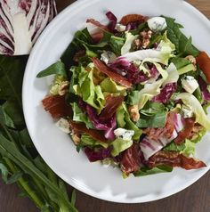 Speck (smoked prosciutto) has a smoky robustness that is bold enough to take on the big flavors of nutritious bitter greens. Toasted walnuts add crunch and crumbled blue cheese adds richness to this salad, which can either stand as a meal on its own or complement wintery dishes with rich flavors like braised meats or pasta.