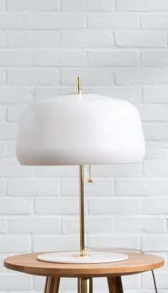 Atelier table lamp in white and brass. Smooth, sleek and modern. £79 | MADE.COM
