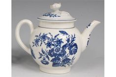 LOT 661 A first period Worcester porcelain teapot and cover, of bullet shape, the cover with flower head finial, the whole underglaze blue printed in the Three Flowers pattern, artists tally mark verso, circa 1770
