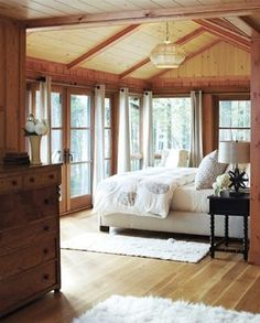 Summer Home Decorating Ideas Inspired by Rustic Simplicity of Canadian Cottages Enclosed Cottage Porch (© Janet Kimber). This has lots of elements I'd love- french doors, wood beams Cabin Homes, Log Homes, Style At Home, Lodge Bedroom, Cozy Bedroom, Bedroom Windows, Bedroom Rustic, Summer Bedroom, Shabby Bedroom