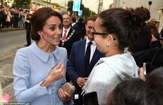 Kate looked elegant in a pale blue skirt suit by Catherine Walker as she arrived in the ci...