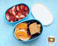 Strawberries with sprinkles, sliced cereal bar & peeled orange