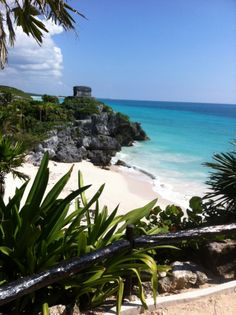 Climb up to the Tulum ruins, overlooking the bright blue Caribbean.