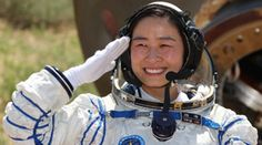 Shenzhou-9 crew member, Liu Yang, exit re-entry capsule.