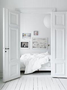 modern white apartment bedroom
