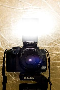 take a blank index card, cut two slits and place in front of flash to create a bounce back light for great photos