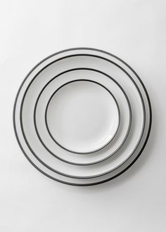 "The finest Limoges porcelain with a hand-painted, brushed matte black rim.      DIMENSIONS     * Charger Plate (12"")     * Dinner Plate (10.5"")     * Salad/Dessert Plate (8.25"")      * Bread Plate (6.25"")      * Soup/Pasta Bowl (7.5"")     * Cup/Saucer Duo     * Demitasse/Saucer Duo DETAI"